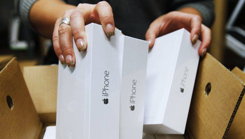 OREM, UT - SEPTEMBER 18: An Apple iPhone 6 phones are taken out of a shipping box at a Verizon store on September 18, 2014 in Orem, Utah. Apple's new iPhone 6 and iPhone 6 Plus go on sale September 20.   George Frey/Getty Images