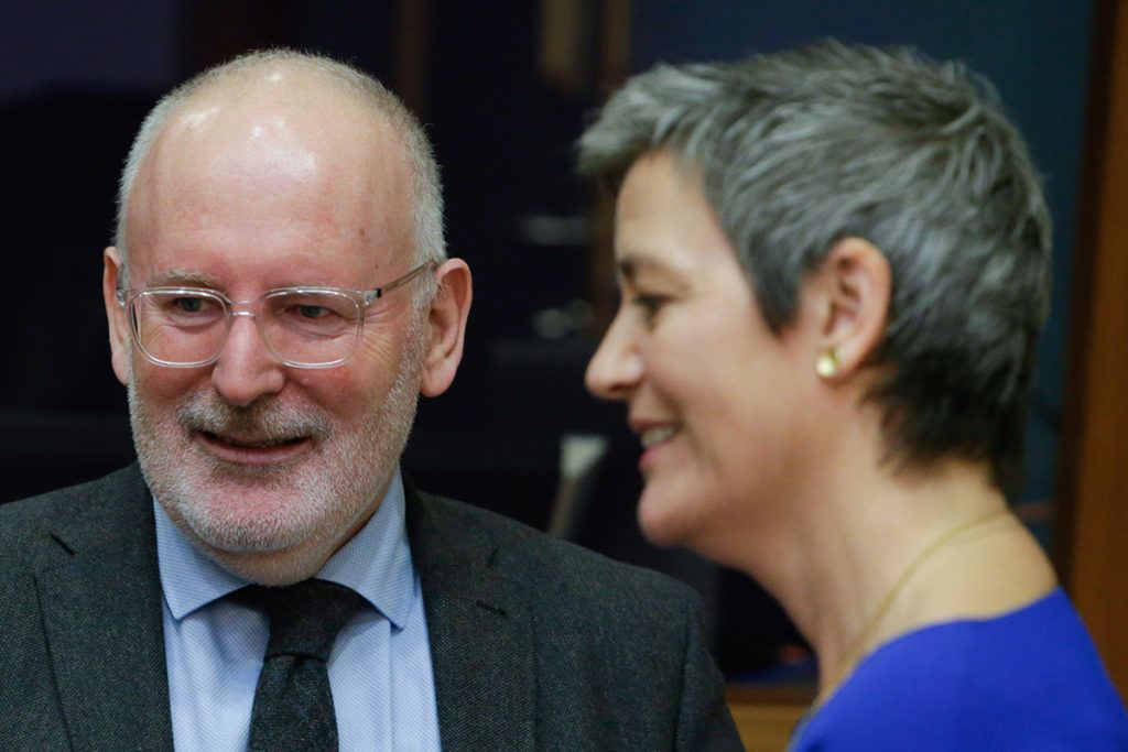 European Commissioner for Economic and Financial Affairs, Taxation and Customs Pierre Moscovici (L), Frans Timmermans, First vice-president of the European Commission for better regulation, inter-institutional relations, the rule of law, and the Charter of Fundamental Rights and EU Commissioner for Competition Margrethe Vestager (R) talk  prior to the EU Commissioners weekly college meeting at the European Commission headquarters in Brussels, on February 6, 2019. (Photo by Aris Oikonomou / AFP)